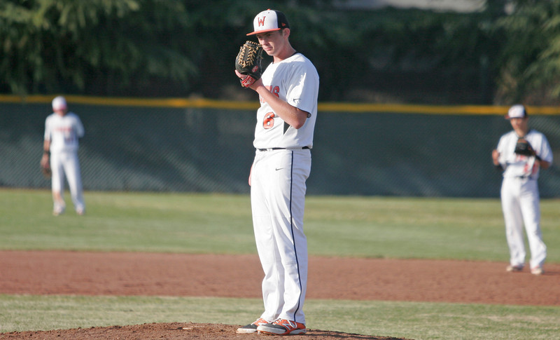 Woodlake Tiger RHP Josh Burgdol struck out six, went 4-for-5 with 4 double, 4 RBIs, and 3 runs scored in Woodlake's 22-4 defeat of Lindsay on March 21, 2014.