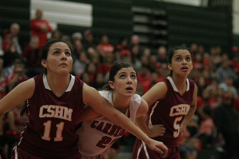 Cantwell-Sacred Heart's Stephanie Guerra (5) and Jesse Flores (11) fight for a rebound with Lindsay Cardinal Kennedy Blue (20) on Wednesday, March 6, 2013.