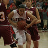 Christina Castro of Lindsay drives between Cantwell-Sacred's Sylvia Garcia and Briana Mercuri on Wednesday, March 6, 2013.