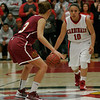 Lindsay Cardinal Christina Castro (10) brings the ball up court against Cantwell-Sacred Heart's Sylvia Garcia (3).