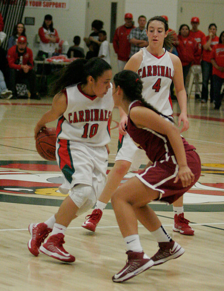 Lindsay Cardinal Christina Castro (10) dribbles behind the back bringing the ball up court against Cantwell-Sacred Heart on Wednesday, March 6, 2013.