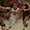 Lindsay Cardinal Christina Castro drives against Cantwell-Sacred Heart's Sylvia Garcia. Cantwell-Sacred Heart 54, Lindsay 40.