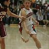 Lindsay's Destiny Garcia drives against Cantwell-Sacred Heart's Kayla Robles on Wednesday, March 6, 2013.