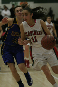 Lindsay Cardinal Megan Salinas (11) brings the ball up court against Exeter Monarch Mekenna DeCraemer (23) during the Division IV semifinal on February 26, 2013. Lindsay 63 - Exeter 48.