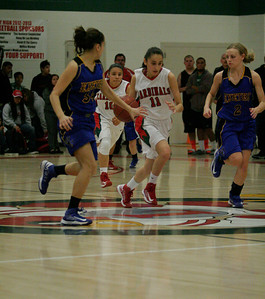 Lindsay Cardinal Megan Salinas (11) bring the ball up court against Exeter Monarchs Jacqueline Hutchenson (2) and Valerie Vargas (34) on February 26, 2013 as Christina Castro (10) follows.