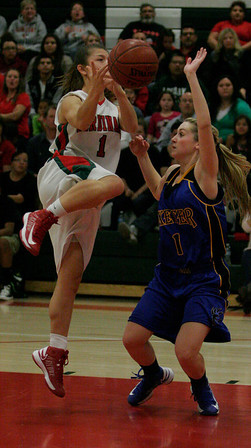 Lindsay Cardinal Destiny Garcia (1) shoots a lay up against Exeter Monrach Amber Atkinson (1) during the Division IV sectional semifinal at Lindsay on February 26, 2013.
