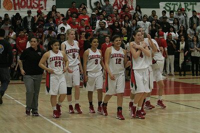 Lindsay Cardinal girls basketball team celebrates their win over Exeter on February 26, 2013.