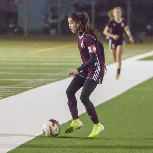 Makenzie Martins (3) dribbles the soccer ball up field against the Madera South Stallions in Central Section soccer playoffs. The Tribe would win by a 6-0 score.