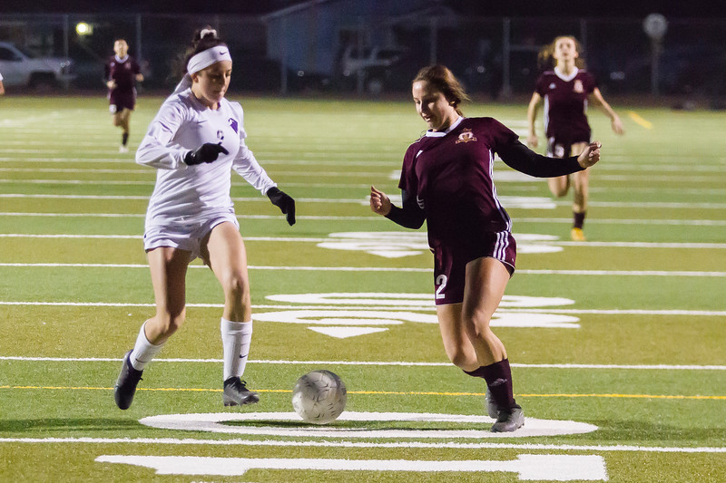 TU Tribe's Alexis Frost pushes the ball up field in The Tribe's 6-0 win over Madera South in Central Section playoff soccer action.