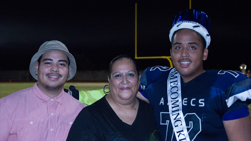 Farmersville Aztec Homecoming King, and lineman, Jessie Salud poses with his family at halftime of the Aztec's game against the Minaret Mustangs.