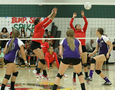 Lindsay Cardinal volleyball players (l to r) Jessica Pabon, Sayla Arguelles, and Adriana Gutierrez attempt to block a Mission Oaks spike.