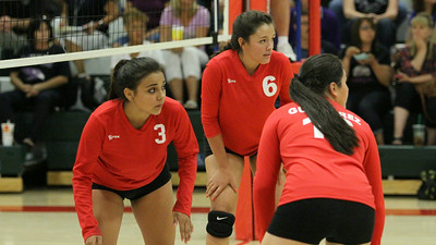 Lindsay Cardinal volleyball players Sayla Arguelles (3), Jessica Pabon (6) and Marlene Gutierrez (16) anticipate the serve in Thursday's match against Mission Oaks.