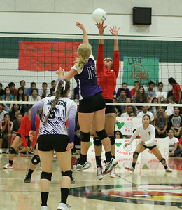 Lindsay Cardinal MH Jessica Pabon (6) blocks a Mission Oaks spike during Thursday's 3-1 match loss to the Hawks.