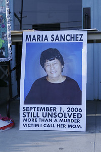 Poster remembering Mary Sanchez who was murdered in her store in Strathmore in September 2006. Her murder remains unsolved. Shown at the Mothers United Against Gang Violence candlelight  vigil on Saturday, March 16, 2013.