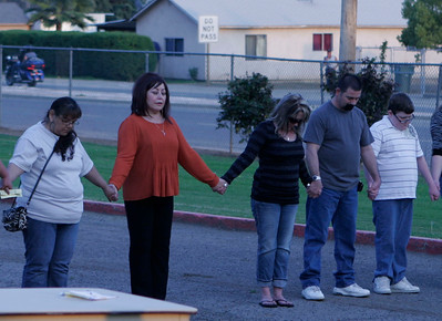 Members of MUAGV whose family members were murdered due to gang violence in a prayer circle (l to r) Irma Vasquez, Mary Martinez, Tami Mitchell, Ronnie Mitchell and their 12 year-old son. (Tami Mitchell is Michael Avalos' mother, Ron is his step father.)