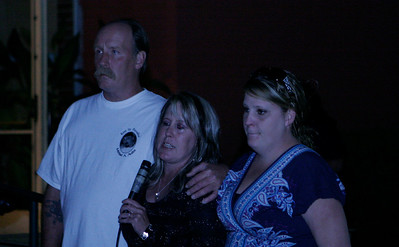 Micheal Avalos' mother Tami Mitchell, center, talks about Micheal's death. On each side are her brother and sister. At the MUAGV Candlelight Vigil March 16, 2013.