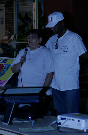 Irma Vazquez, mother of gang murder victim Vincent Ramirez, speaking at the MUAGV rally on Saturday, March16, 2013. Pastor Loyd Johnson provides her comfort and support.
