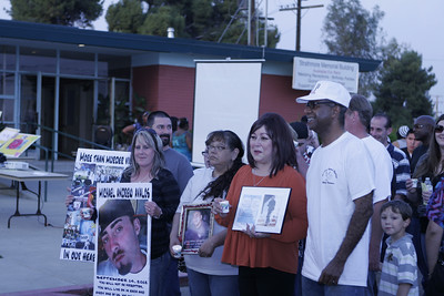 At Mothers United Against Gang Violence Candlelight Vigil March Ron and Tami Mitchell (Michael Avalos), Irma Vazquez (Vincent Ramirez), Mary Martinez (Francisco Martinez) and Pastor Loyd Jonhson begin the march. The little boy in the stripped shirt is Michael Avalos' 5-year old brother.