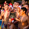 The Tulare Western Mustang water polo team poses the the CIF Central Section D3 Championship plaque. The Mustang defeated the Mt. Whitney Pioneers 16-11 to claim the sectional title.