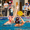 Mt . Whitney water polo player Jacob Canaday attempts a shot against Tulare Western's Aidan Champagne (10) in the CIF Central Section D# Water Polo championship game.  Tulare Western would upset the top-seeded Pioneers by an 16-11 score to be crowned the Central Section Champs.