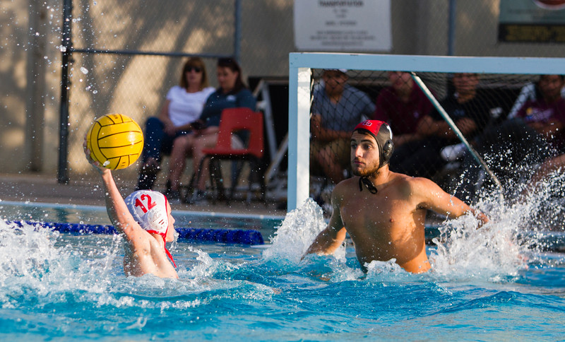 Tulare Western's Zac Schoenau (12) attempts a shot on Mt. Whitney goalkeeper Ethan Bennett (1) in the CIF Central Section D3 Boys Water Polo Championship match. Tulare Western would prevail by a 16-11 score to take the title.