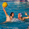 Mt. Whitney's Travis Applegate (12) attempts a shot over Tulare Western defender Duncan Champagne (7) during the CIF Central Section D3 Championship. Tulare Western captured the crown with a 16-11 defeat of the Pioneers.