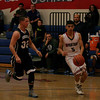 Carlos Lopez (5) of Strathmore drives the lane against Farmersville's Sam Metcalf (32) in the Spartan's 45-42 loss.