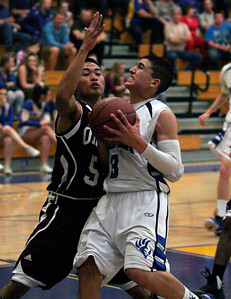 Exeter point guard Brandon Briones (3) drives the paint against Orosi during their February 25th playoff game. The Monarch's won the game 63-43.