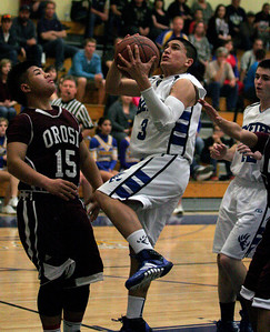 Exeter Monarch Brandon Briones (3) drives to the basket against the Orosi Cardinals during the Monarch's 63-43 pllayoff win over Orosi.