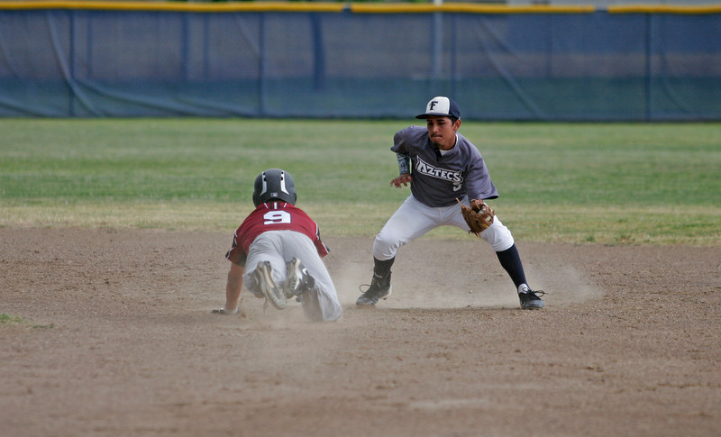 Farmersville 2nd Baseman Isaiah Hernandez (5) is set to tag out Orosi Cardinal Fernando Ramiez (9) during an attempted steal. Farmersville went on to a 14-2 win to advance to the CIF Central Section Division VI final against Minarets on Saturday May 24th at Recreation Park in Visalia.