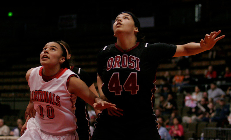 Lindsay Cardinal Christina Castro (10) fights for position against Orosi Cardinal C Alyssa Alvarado (44) in Lindsay's 50-38 win at the CIF Central Section Division IV Final.