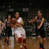 Lindsay's Christina Castro gets set to dish 1 of her 6 assists during the Cardinal's 50-38 win over Orosi in the CIF Central Section Division IV final at Selland Arena on Satruday, March 8.