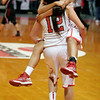 Lindsay Cardinal Sayla Arguelles jumps into the arms of Alexis Gutierrez in celebration of the Cardinal's second CIF Central Section Championship.