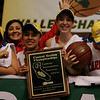 Lindsay's Chelsea Alvarez, Christina Castro, Ashley Baker, and Destiny Garcia celebrate the Cardinal's CIF Central Section Division IV Championship.