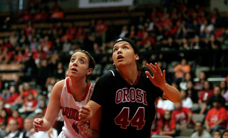 Lindsay Cardinal Ashley Baker fights for a rebound against Orosi Cardinal Alyssa Alvarado in Lindsay's 50-38 CIF Central Section title win.
