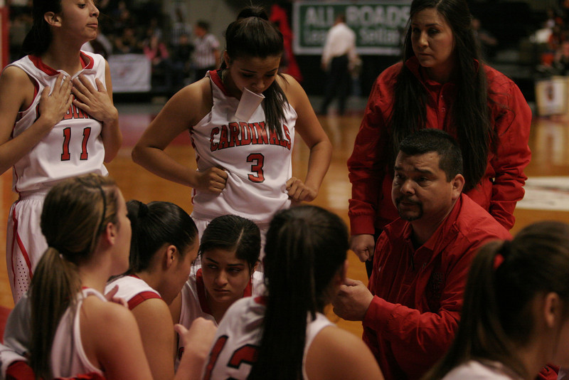 Lindsay Cardinal coach Frankie Arguelles discusses strategy during a time out in the Cardinal's 50-38 victory over the Orosi Cardinals in the CIF Central Section Division IV final.