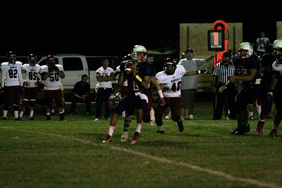 Strathmore Spartan quarterback Carlos Lopez drops back to pass during the Spartan's 42-14 win over Orosi.