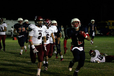 Ricardo Madrigal (2) of Strathmore evades the Orosi defenders in the Spartan's 42-14 defeat of the Orosi Cardinals.