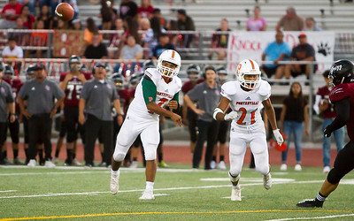 Porterville Panther quarterback Hector Nava Jr. (7) completed 14 of 21 passes for 331 yards in the Panthers 53-7 over Granite Hills.