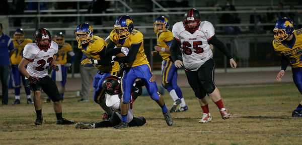 Exeter WR Alex Cortez breaks a tackle on his way to one of his 3 touchdowns against Rosamond in Friday's Central Section Divisioin IV playoff win.