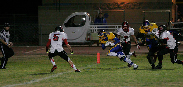 Exeter Monarch WR Chad Zeibak scores on one of his two touchdown reception against Rosamond in their Central Section Division IV playoff game at Exeter on November 15.