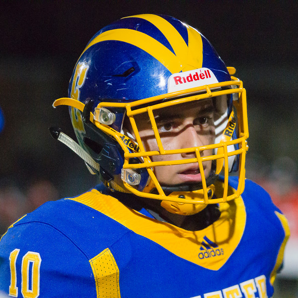 Exeter Monarch QB Chris Lopez listens to the coach's instructions in the Monarch's 58-18 loss to the Selma Bears in CSL play.