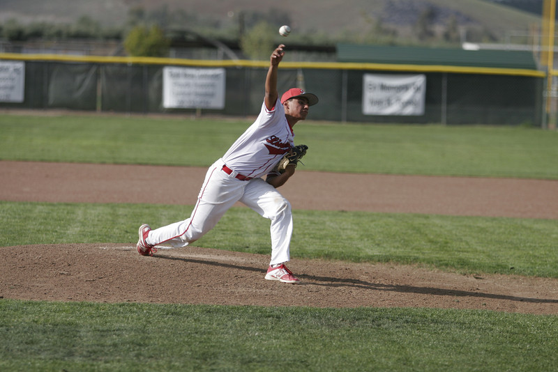 Lindsay pitcher Israel Uribe hurls a pitch against Sierra Pacific on Friday, April 11, 2014.