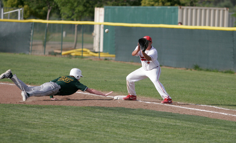Sierra Pacific SS Matthew Leslie dives back to 1st base during a pick off attempt by Lindsay pitcher Israel Uribe. Sierra Pacific prevailed over Lindsay 9-4.