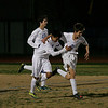 Exeter Monrach MF Justin Perez (2) gets congratulations from teammates after scoring a goal against Sierra Pacific in their 3-2 victory in the CIF Division VI playoffs.