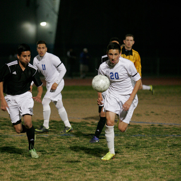 Exeter Monarch MF Ryan Buchanan chases down the ball during the Monarch's 3-2 playoff victory over Sierra Pacific on Tuesday, February 18th.