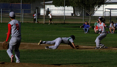 Strathmore Pitcher Eric Lopez attempts to pick off Sierra Pacific Pitcher Connor Mannix on Tuesday, March 19, 2013.