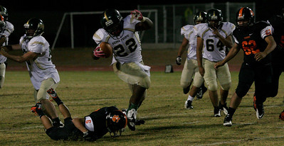 Sierra Pacific RB DeAreon Willis dodges the takle of Woodlake DB Tim Diaz as Woodlake LB Nick Legrete converges in Woodlake's 50-27 win.