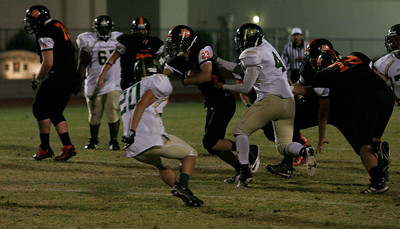 Woodlake Tiger RB John Kulick (23) had 100 yards on 19 rushes in Woodlake's 50-27 win over the Sierra Pacific Golden Bears on Friday, November 1, 2013.
