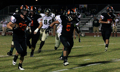 Johnny Rios (5) leads Johnny Kulick (2) during a rush against Sierra Pacific. Woodlake won 50-27.